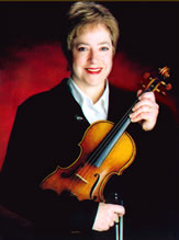 Kate Obrien holding a violin